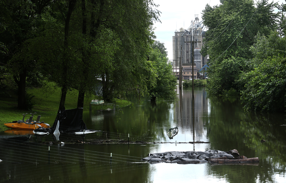 The Cargill grain elevator can be seen in the distance with flooding evident behind homes along N. Washington St. north of the Meredosia River Bridge. David Spencer/The State Journal-Register