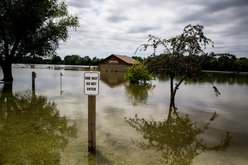 Flood waters from the Illinois River overtake the Havana Nature Center as it continues to rise, Thursday, June 25, 2015, in Havana, Ill. The Nature Center, which is built on the banks of the Illinois River, was built with flood gates to allow water to flow through the structure to keep it from being damaged. Justin L. Fowler/The State Journal-Register