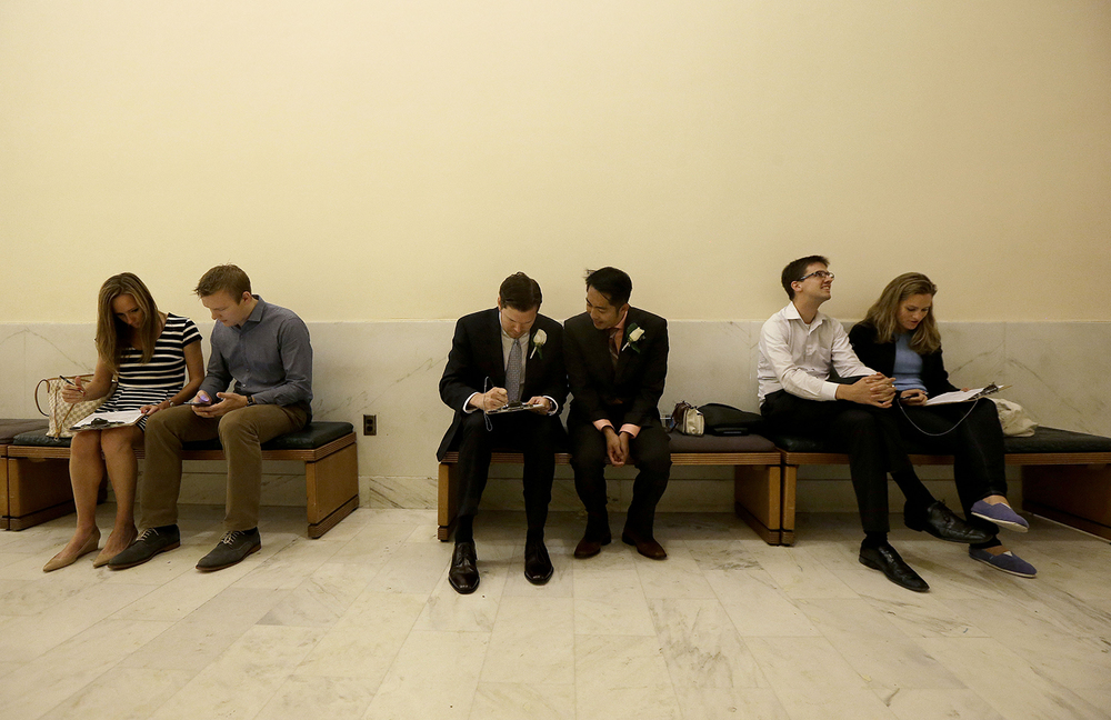 Jay Mark Streeter Jr., center, left, and Hai Nguyen fill out a marriage license application between couples Lauren Blears and Ben Byrne, left, and Alex Wooten and Jelena Djordjevic at City Hall John Pleskach in San Francisco, Friday, June 26, 2015. Nguyen and Streeter were planning to marry today, after the U.S. Supreme Court ruled that  same-sex couples have the right to marry nationwide.  (AP Photo/Jeff Chiu)