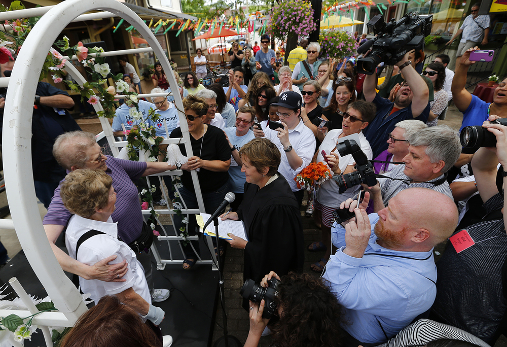 Marge Eide, 77, and Ann Sorrell, 78, of Ann Arbor, a couple for 43 years, exchange vows in Ann Arbor, Mich., following a ruling by the US Supreme Court that struck down bans on same sex marriage nation wide Friday, June 26, 2015. (AP Photo/Paul Sancya)