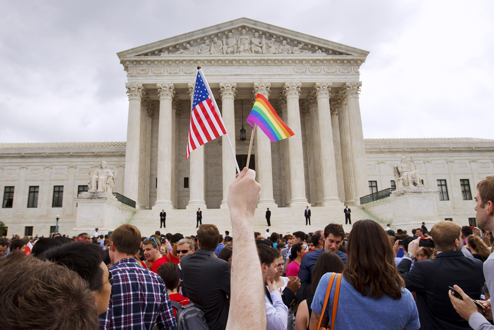 The crowd celebrates outside of the Supreme Court in Washington, Friday June 26, 2015, after the court declared that same-sex couples have a right to marry anywhere in the US. (AP Photo/Jacquelyn Martin)