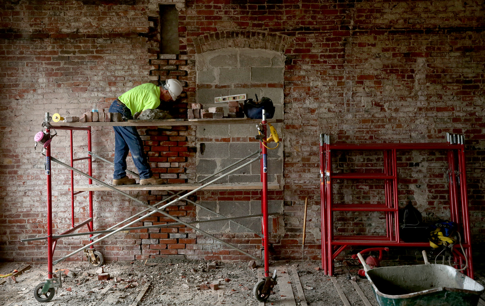 Siciliano, Inc. employee and mason Cliff Foley reconstructs a brick wall on the sixth floor of the Booth building. David Spencer/The State Journal-Register