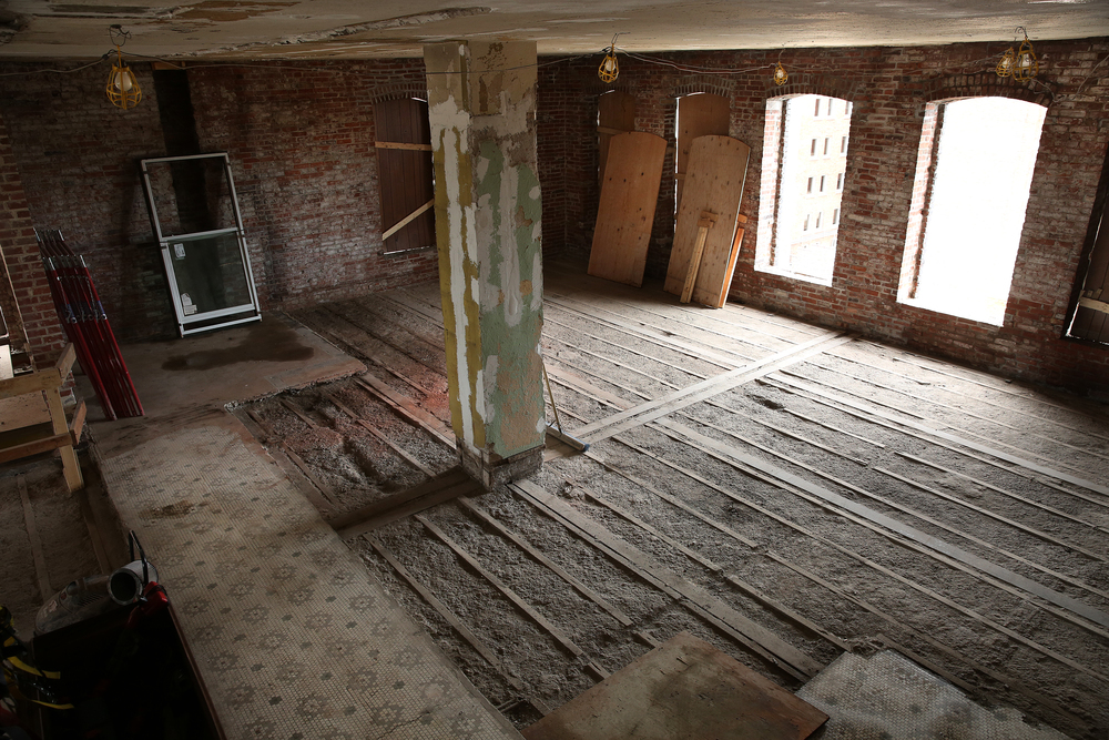 This view shows a section of the recently gutted seventh floor of the Booth building. An original feature at bottom left are mosaic floor tiles dating to when the building first opened in 1906. David Spencer/The State Journal-Register