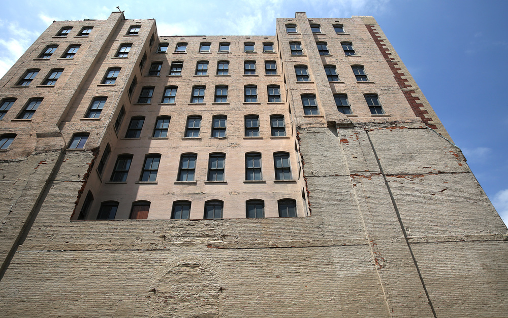 The view of the south-side of the Ferguson building after removal of the brick, with the third story windows seen at bottom. David Spencer/The State Journal-Register