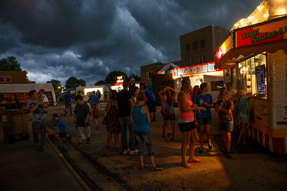 A line of storm clouds blows over the Pawnee Prairie Days as patrons wait in line for food Thursday, June 25, 2015. Ted Schurter/The State Journal-Register