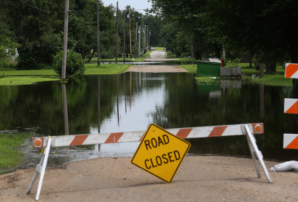 A view of the now closed Lake Rd., with sections having approximately 2-3' of water. David Spencer/The State Journal-Register