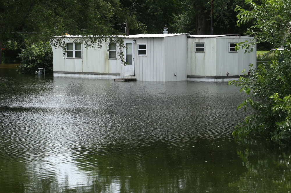 Heather Baker's home in the 400 block of Lake Rd. was surrounded by deep water on Thursday. David Spencer/The State Journal-Register