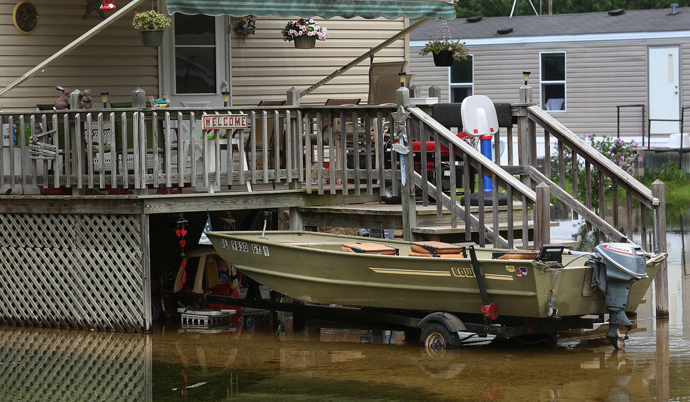 A homeowner along Gaskill Rd. was not taking any chances, with a motorboat parked right out front for a quick getaway if needed. David Spencer/The State Journal-Register