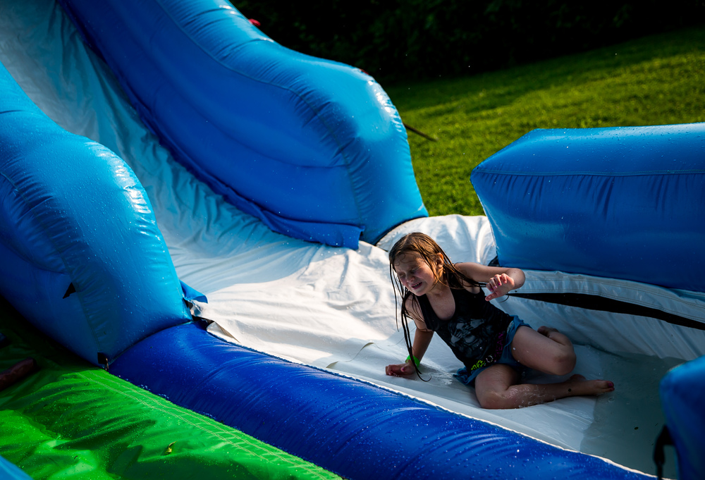 Haylie Sweets, 6, prepares for the water that awaits her at the bottom of the water slide during the Riverton Fire Crackin' Festival at the Knights of Columbus Marian Council 3914, Friday, July 3, 2015, in Riverton, Ill. Justin L. Fowler/The State Journal-Register