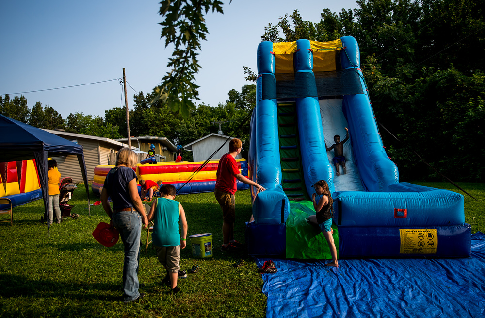The water slide is a popular attraction for the youth during the Riverton Fire Crackin' Festival at the Knights of Columbus Marian Council 3914, Friday, July 3, 2015, in Riverton, Ill. Justin L. Fowler/The State Journal-Register