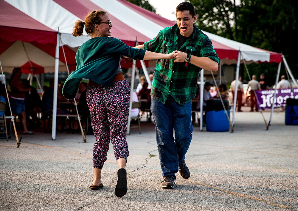 Maggie McGowan, left, and Nick Badger, right, dance along to the Wolf Crick Boys during the Riverton Fire Crackin� Festival at the Knights of Columbus Marian Council 3914, Friday, July 3, 2015, in Riverton, Ill. Justin L. Fowler/The State Journal-Register