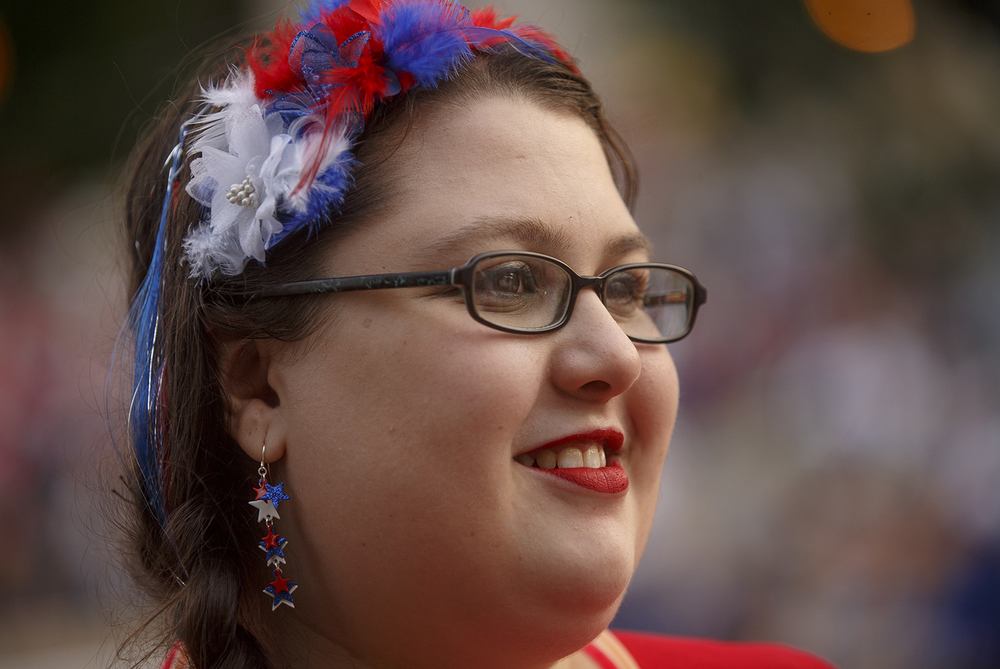 Jodi Owen sports dangly star earrings and patriotic colors as she waited for the fireworks on the lawn of the Capitol Saturday, July 4, 2015. Ted Schurter/The State Journal-Register