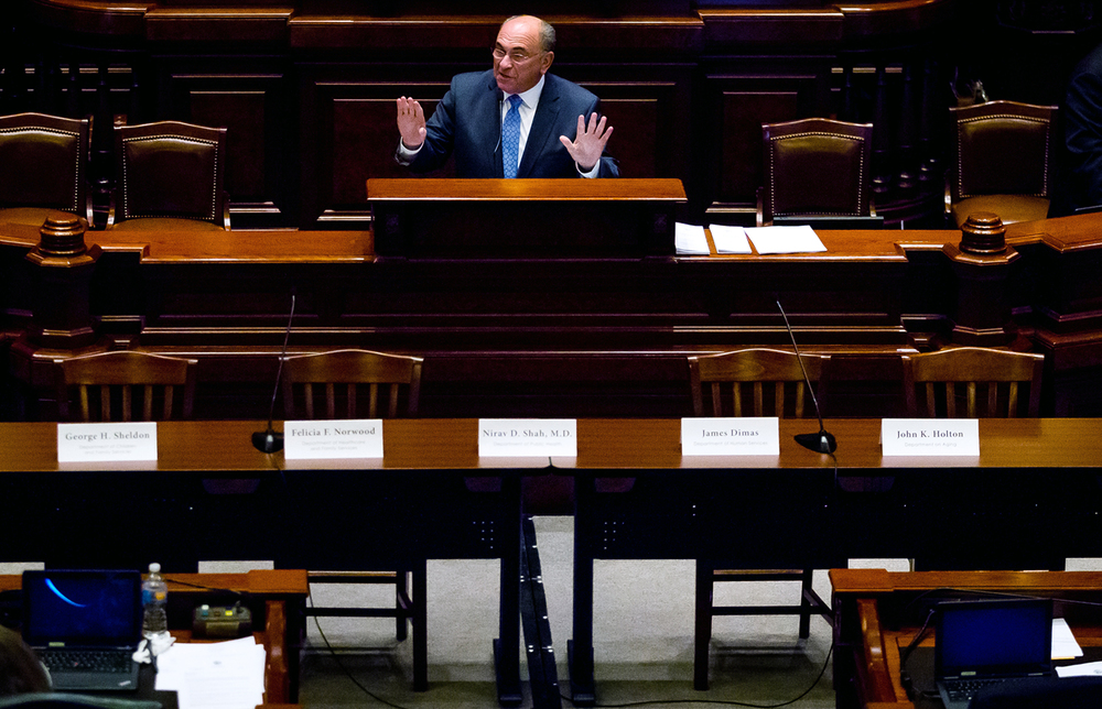 Deputy Majority Leader Rep. Lou Lang explains that after a letter requesting the appearance of several heads of state agencies they were not present to testify during a House Committee of the Whole at the Illinois State Capitol, Tuesday, June 30, 2015, in Springfield, Ill. Tim Nuding, the Director of Governor's Office of Management and Budget, along with Jason Barclay, Governor's General Counsel, were present to testify. Justin L. Fowler/The State Journal-Register