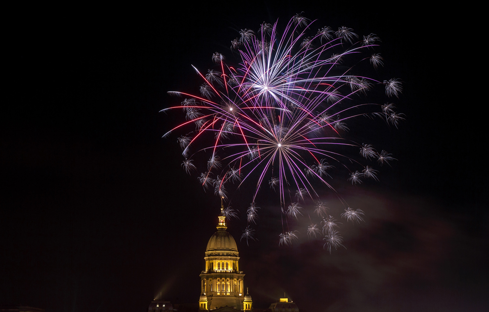Fireworks explode above the Capitol dome during the Capital City Celebration Saturday, July 4, 2015. Ted Schurter/The State Journal-Register