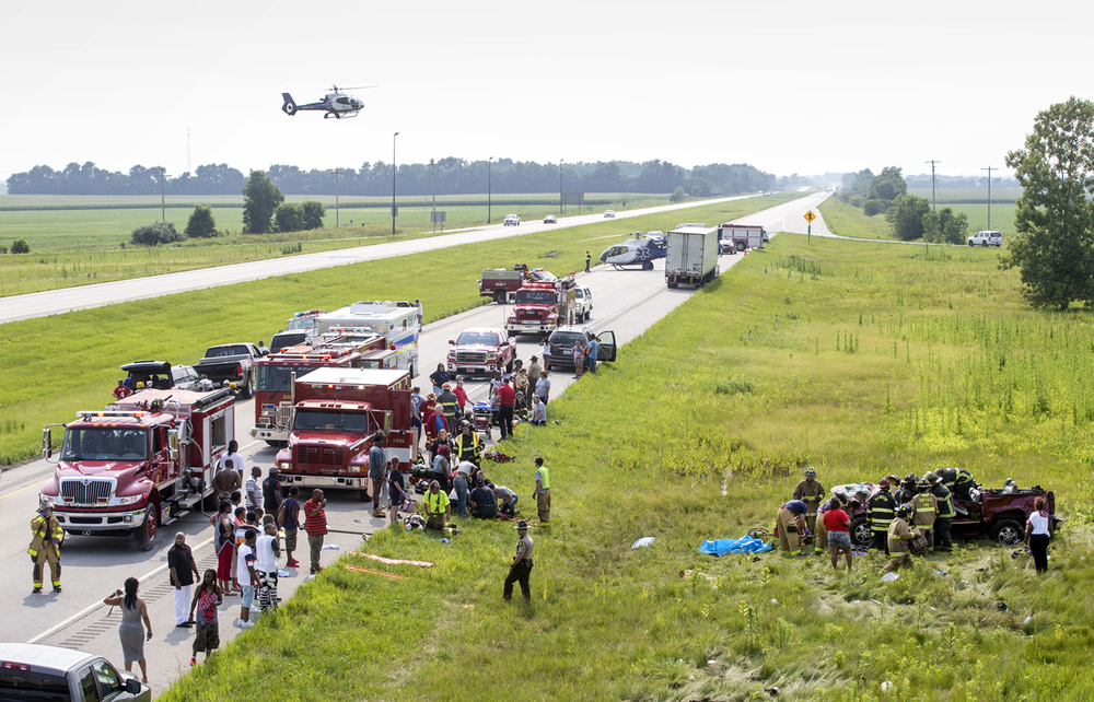 A second emergency helicopter arrives at the scene of an multiple injury SUV rollover accident in the westbound lanes of Interstate 72 at the Buffalo exit Saturday, July 4, 2015.  Ted Schurter/The State Journal-Register