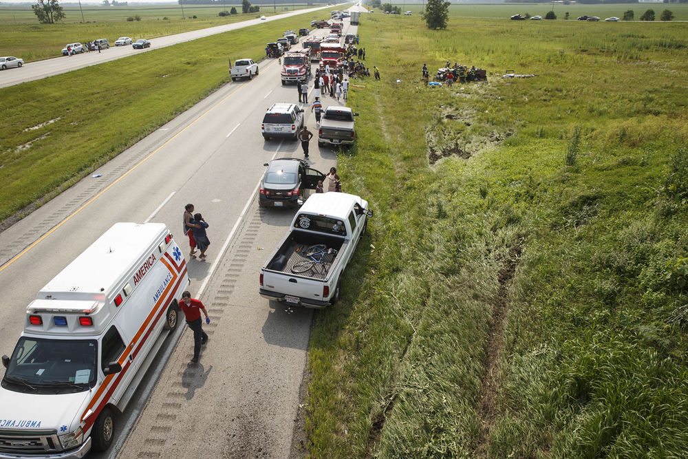 The tracks of an SUV involved in a multiple-injury rollover accident on Interstate 72 are visible on the hill of the overpass Sunday, July 4, 2015.  Ted Schurter/The State Journal-Register