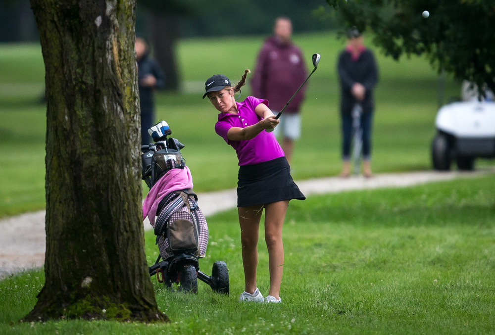 Anna Carter hits out of the rough on her approach shot on the No. 18 hole during the Drysdale Junior Golf Tournament at Lincoln Greens Golf Course, Tuesday, July 7, 2015, in Springfield, Ill. Justin L. Fowler/The State Journal-Register