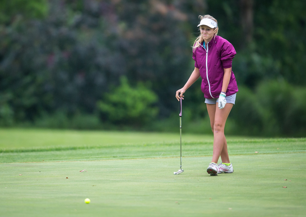 Madison Humke reacts after a putt goes long on the No. 18 hole during the Drysdale Junior Golf Tournament at Lincoln Greens Golf Course, Tuesday, July 7, 2015, in Springfield, Ill. Justin L. Fowler/The State Journal-Register