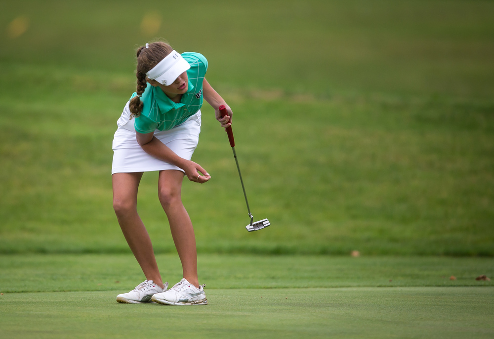 Emily Ducaji tries to will a putt in on the No. 18 hole during the Drysdale Junior Golf Tournament at Lincoln Greens Golf Course, Tuesday, July 7, 2015, in Springfield, Ill. Justin L. Fowler/The State Journal-Register