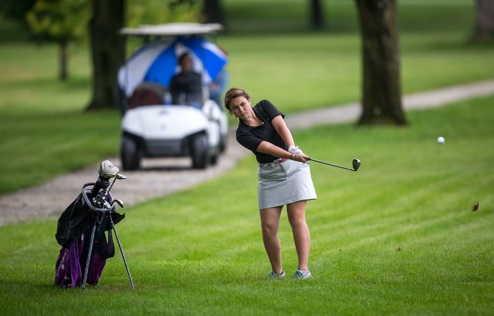 Brielle Marten hits her approach shot out of the rough on the No. 18 hole during the Drysdale Junior Golf Tournament at Lincoln Greens Golf Course, Tuesday, July 7, 2015, in Springfield, Ill. Justin L. Fowler/The State Journal-Register