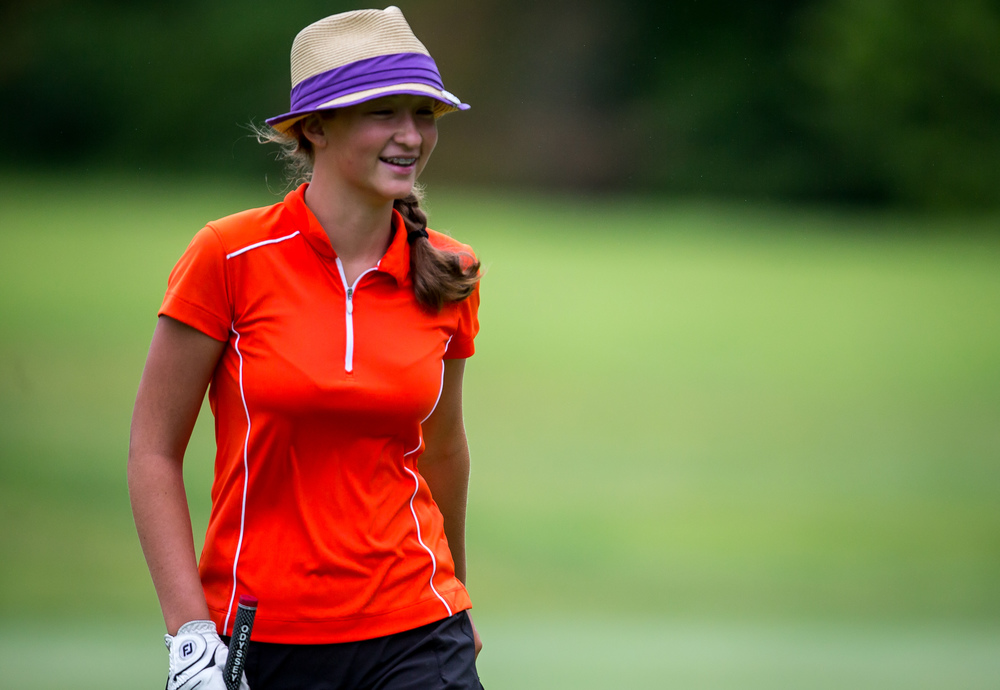 Lauren Hawley cracks a smile walking off the green for the No. 18 hole during the Drysdale Junior Golf Tournament at Lincoln Greens Golf Course, Tuesday, July 7, 2015, in Springfield, Ill. Justin L. Fowler/The State Journal-Register