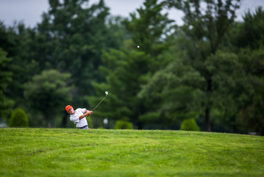 Zach Walsh hits an approach shot on the No. 14 hole during the Drysdale Junior Golf Tournament at Lincoln Greens Golf Course, Tuesday, July 7, 2015, in Springfield, Ill. Justin L. Fowler/The State Journal-Register