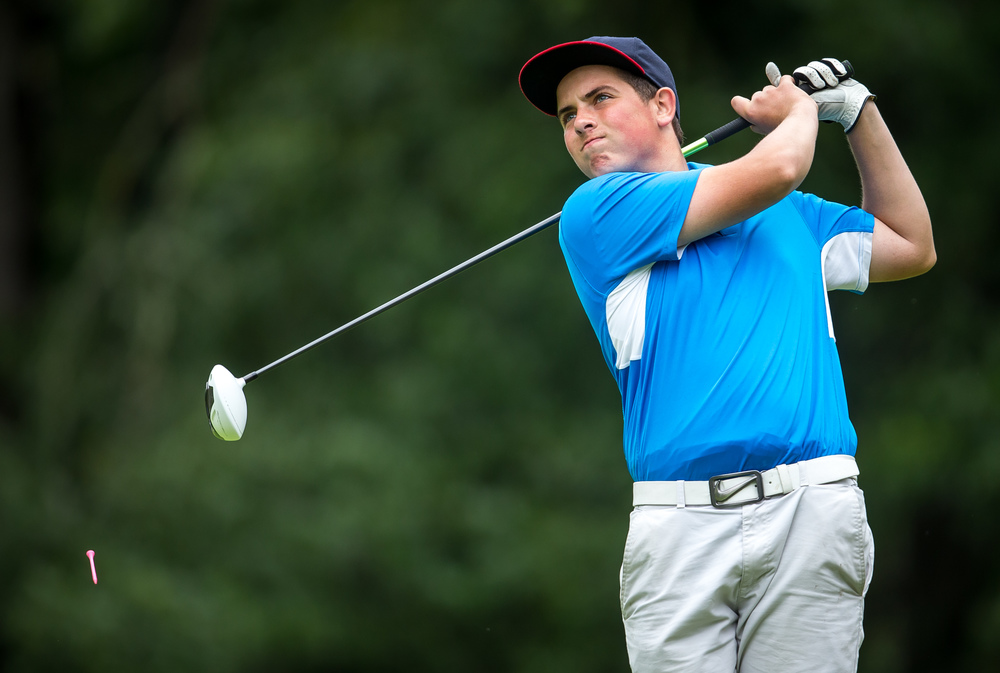 Evan Caselton watches his tee shot off the No. 15 hole during the Drysdale Junior Golf Tournament at Lincoln Greens Golf Course, Tuesday, July 7, 2015, in Springfield, Ill. Justin L. Fowler/The State Journal-Register