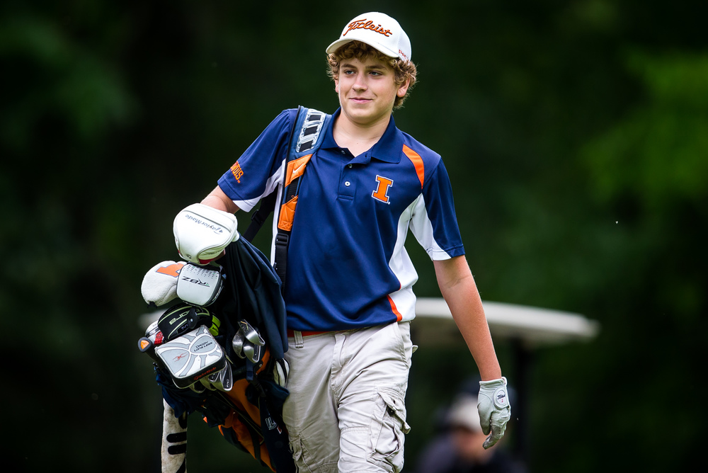 Alex Anderson packs up his clubs as he heads down the fairway on the No. 15 hole during the Drysdale Junior Golf Tournament at Lincoln Greens Golf Course, Tuesday, July 7, 2015, in Springfield, Ill. Justin L. Fowler/The State Journal-Register