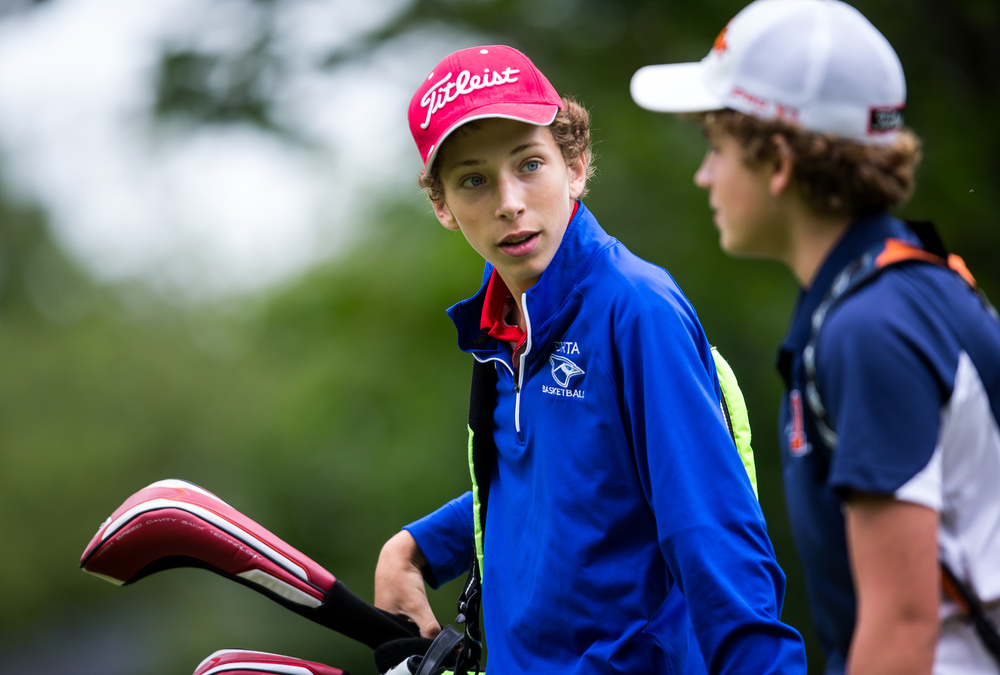 Ben Baker, center, talks with Alex Anderson as the pairing walk off the tee box on the No. 15 hole during the Drysdale Junior Golf Tournament at Lincoln Greens Golf Course, Tuesday, July 7, 2015, in Springfield, Ill. Justin L. Fowler/The State Journal-Register