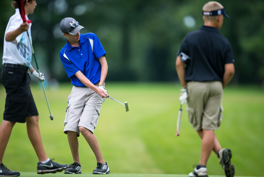 Josh Gray reacts as his putt heads towards the cup on the No. 15 hole during the Drysdale Junior Golf Tournament at Lincoln Greens Golf Course, Tuesday, July 7, 2015, in Springfield, Ill. Justin L. Fowler/The State Journal-Register