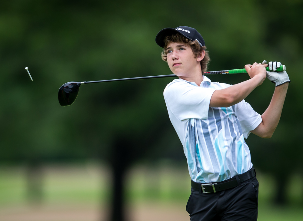 Benjamin Rademaker watches his tee shot off the No. 16 hole during the Drysdale Junior Golf Tournament at Lincoln Greens Golf Course, Tuesday, July 7, 2015, in Springfield, Ill. Justin L. Fowler/The State Journal-Register