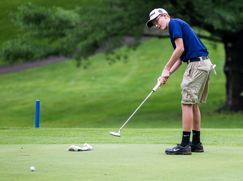 Austen Floyd hits a putt on the on No. 2 hole during the Drysdale Junior Golf Tournament at Pasfield Golf Course, Thursday, July 9, 2015, in Springfield, Ill. Justin L. Fowler/The State Journal-Register