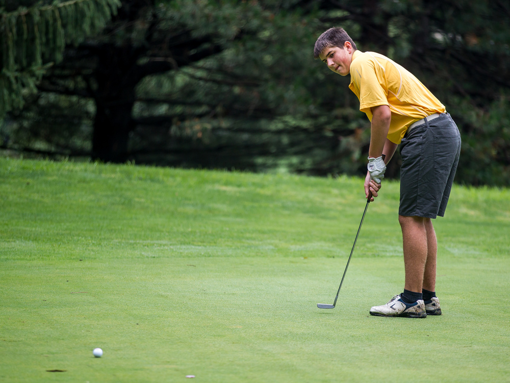 Clayton Alewelt sinks a putt on the No. 2 hole during the Drysdale Junior Golf Tournament at Pasfield Golf Course, Thursday, July 9, 2015, in Springfield, Ill. Justin L. Fowler/The State Journal-Register