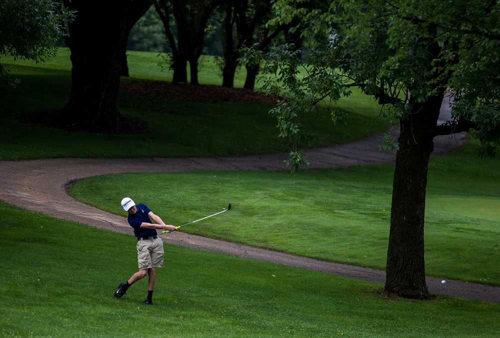 Austen Floyd hits his second shot out of the rough on the No. 2 hole during the Drysdale Junior Golf Tournament at Pasfield Golf Course, Thursday, July 9, 2015, in Springfield, Ill. Justin L. Fowler/The State Journal-Register