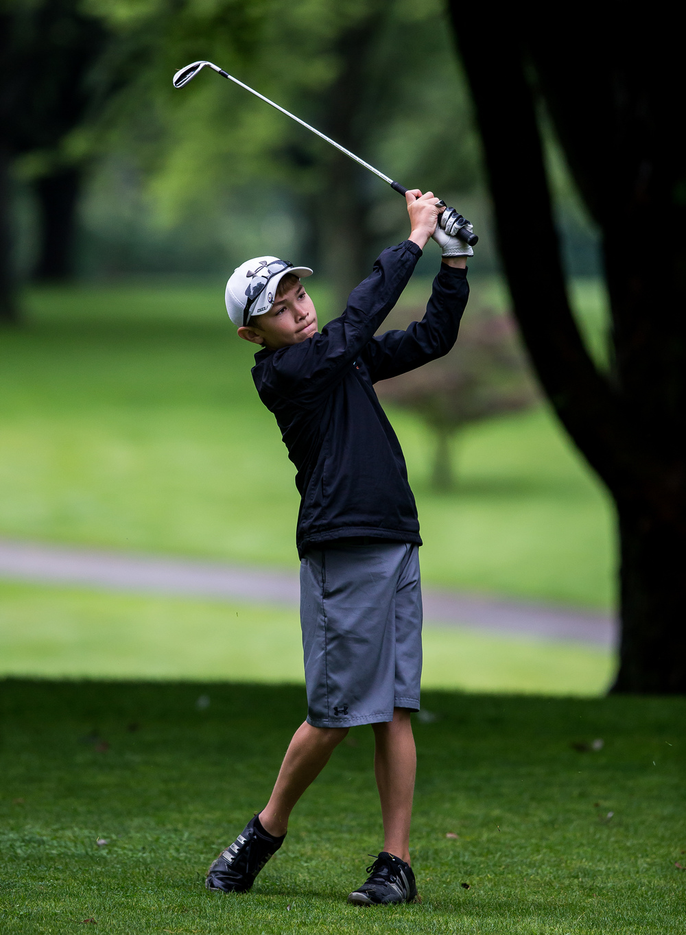 Alex White hits an approach shot on the No. 3 hole during the Drysdale Junior Golf Tournament at Pasfield Golf Course, Thursday, July 9, 2015, in Springfield, Ill. Justin L. Fowler/The State Journal-Register