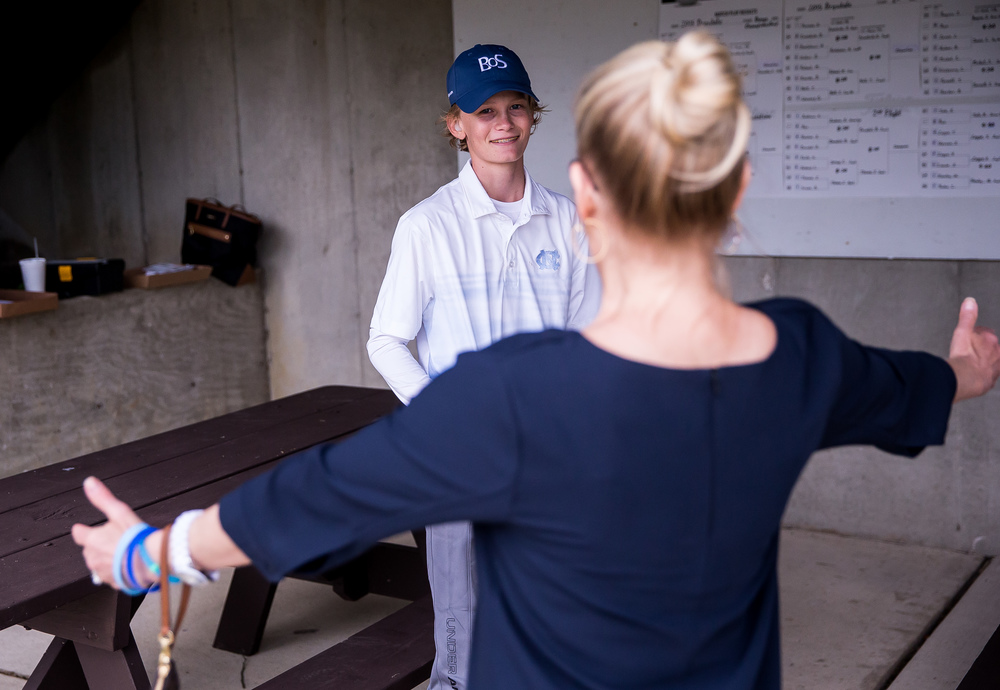 James Tureskis gets a hug from his aunt, Tina Kavish after winning the Championship Flight for the 12-13 division during the Drysdale Junior Golf Tournament at Pasfield Golf Course, Thursday, July 9, 2015, in Springfield, Ill. Justin L. Fowler/The State Journal-Register