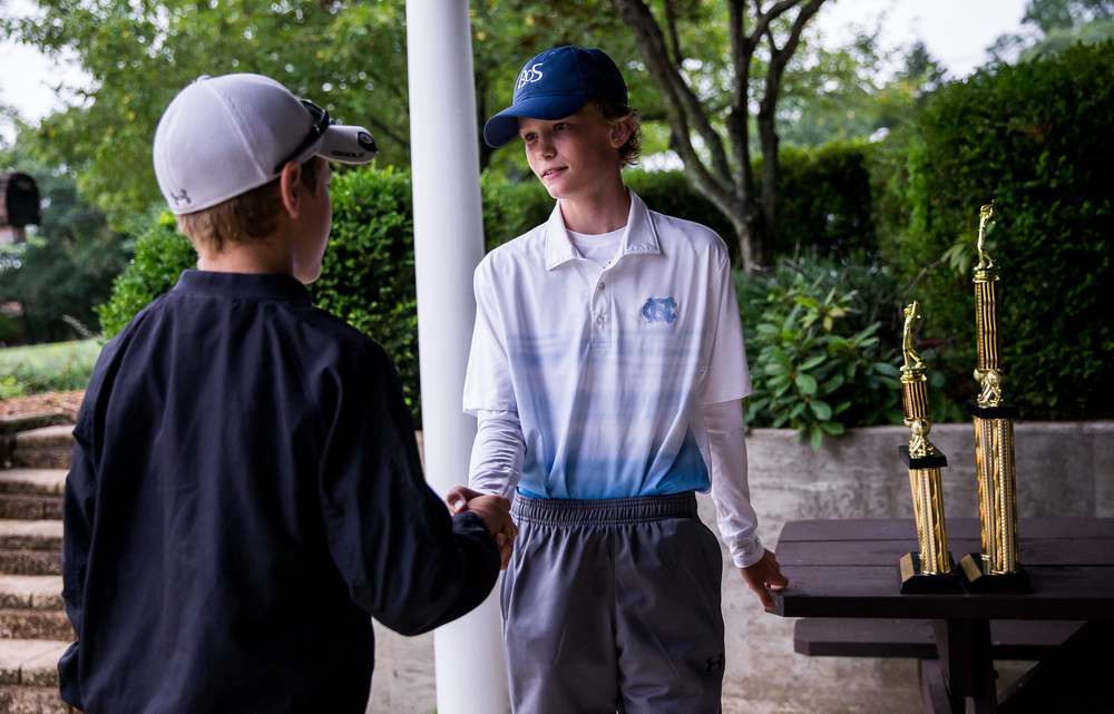 James Tureskis, center, gets hand shake from Alex White, left, after defeating him in the Championship Flight for the 12-13 division during the Drysdale Junior Golf Tournament at Pasfield Golf Course, Thursday, July 9, 2015, in Springfield, Ill. Justin L. Fowler/The State Journal-Register