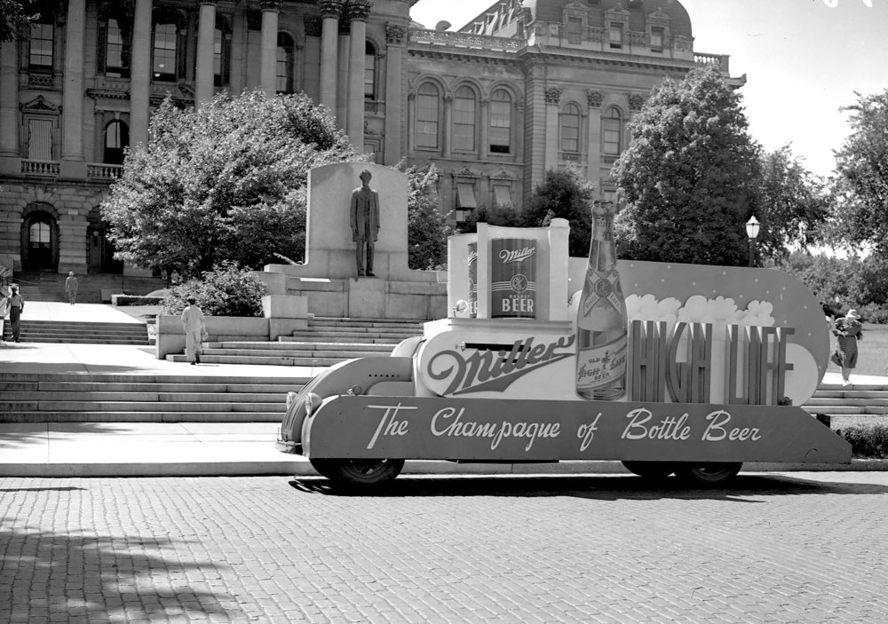 Miller Beer car in front of state capitol, July 18, 1941