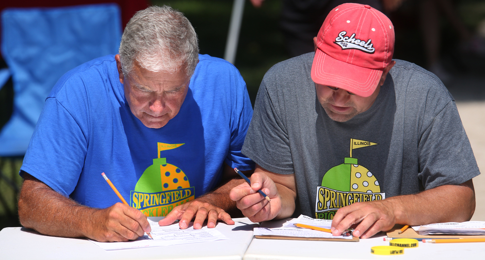 Tournament officials Doug Briggs and Dan Bryd go over match results Sunday. David Spencer/The State Journal-Register