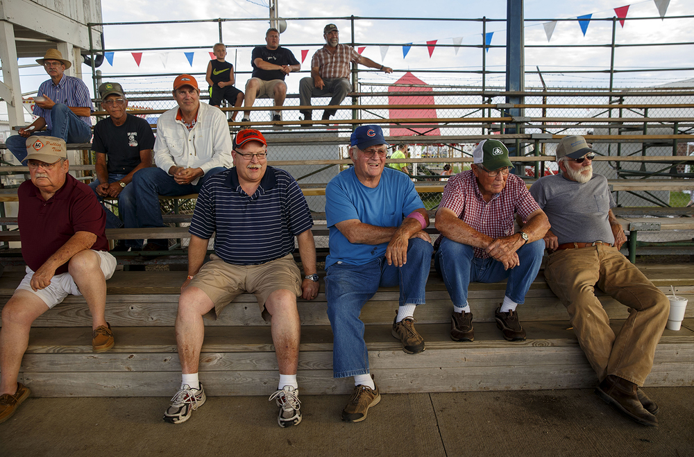 A small crowd takes in the antique tractor pull during the Menard County Fair Wednesday, July 15, 2015. The tractor pull resumes Saturday; the fair continues through July 19th. Ted Schurter/The State Journal-Register