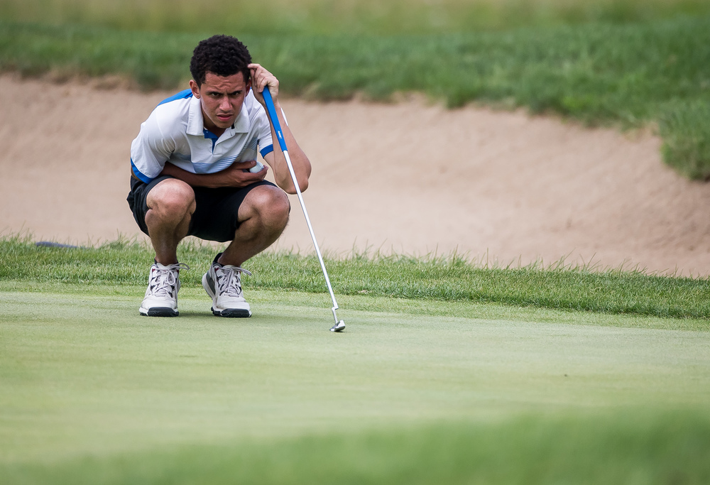 Conor Dore lines up a putt on the No. 15 hole during the 85th Illinois State Amateur Championship at Panther Creek Country Club, Thursday, July 16, 2015, in Springfield, Ill. Justin L. Fowler/The State Journal-Register