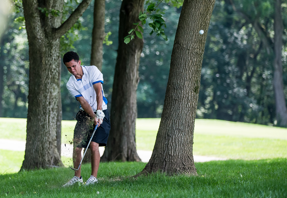Conor Dore hits his second shot out of the woods on the No. 17 hole during the 85th Illinois State Amateur Championship at Panther Creek Country Club, Thursday, July 16, 2015, in Springfield, Ill. Justin L. Fowler/The State Journal-Register
