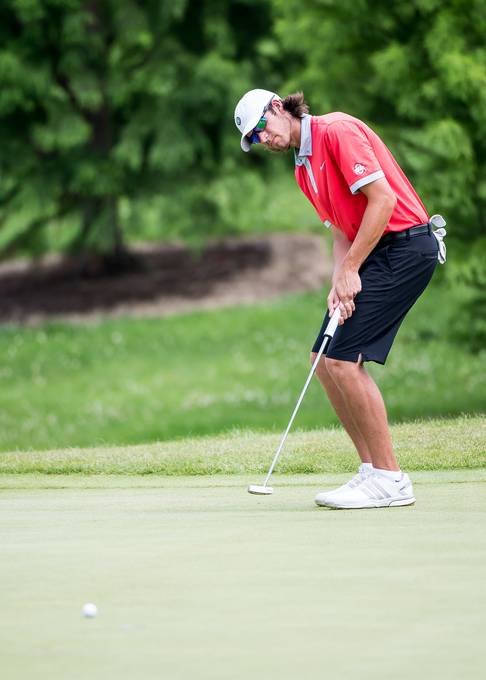 Tee-K Kelly reacts as his putt just misses the cup on the No. 2 hole during the 85th Illinois State Amateur Championship at Panther Creek Country Club, Thursday, July 16, 2015, in Springfield, Ill. Justin L. Fowler/The State Journal-Register