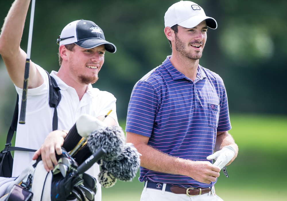 Brian Bullington is all smiles after his second shot hit close to the pin on the No. 4 hole during the 85th Illinois State Amateur Championship at Panther Creek Country Club, Thursday, July 16, 2015, in Springfield, Ill. Justin L. Fowler/The State Journal-Register