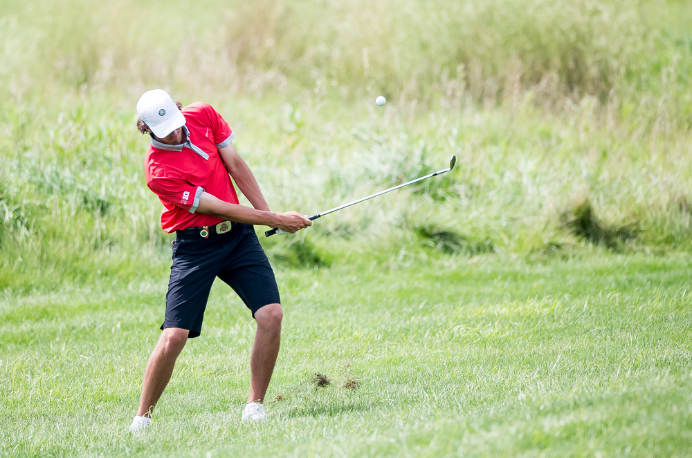 Tee-K Kelly hits a shot out of the rough up on to the green on the No. 4 hole during the 85th Illinois State Amateur Championship at Panther Creek Country Club, Thursday, July 16, 2015, in Springfield, Ill. Justin L. Fowler/The State Journal-Register
