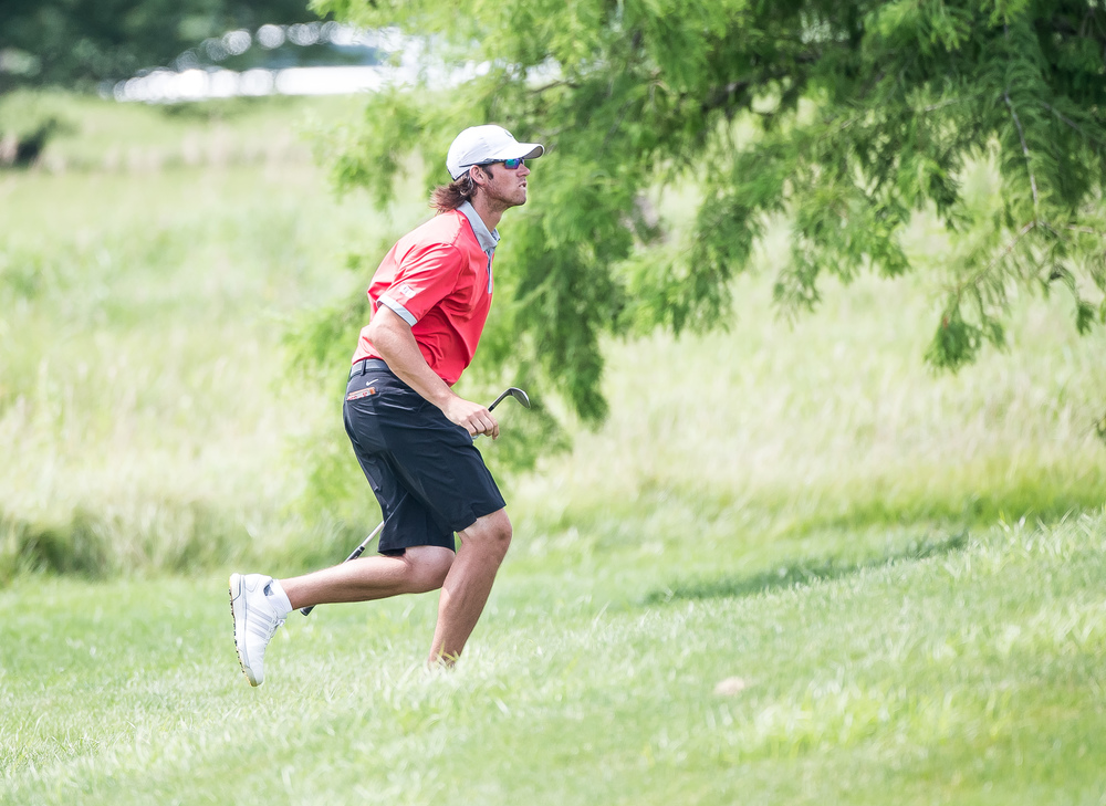 Tee-K Kelly runs up the hill to see how his shot ended on the green for the No. 4 hole during the 85th Illinois State Amateur Championship at Panther Creek Country Club, Thursday, July 16, 2015, in Springfield, Ill. Justin L. Fowler/The State Journal-Register