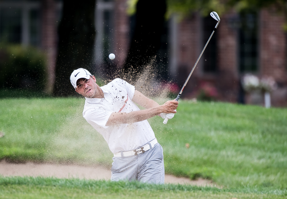 Jake Erickson hits out of the sand on the No. 8 hole during the 85th Illinois State Amateur Championship at Panther Creek Country Club, Thursday, July 16, 2015, in Springfield, Ill. Justin L. Fowler/The State Journal-Register