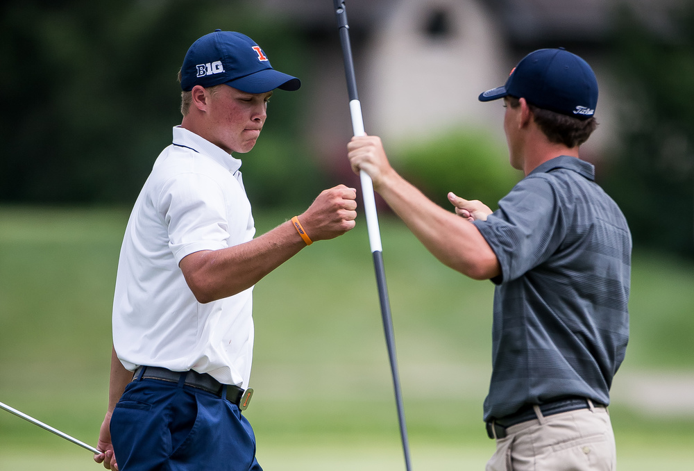 Nick Hardy gets a fist bump from his caddy after making a birdie putt on the No. 8 hole during the 85th Illinois State Amateur Championship at Panther Creek Country Club, Thursday, July 16, 2015, in Springfield, Ill. Justin L. Fowler/The State Journal-Register
