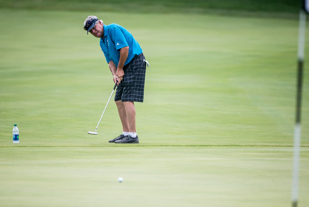 Dave Ryan tries a long putt off the fringe on the No. 19 hole during the 85th Illinois State Amateur Championship at Panther Creek Country Club, Thursday, July 16, 2015, in Springfield, Ill. Justin L. Fowler/The State Journal-Register