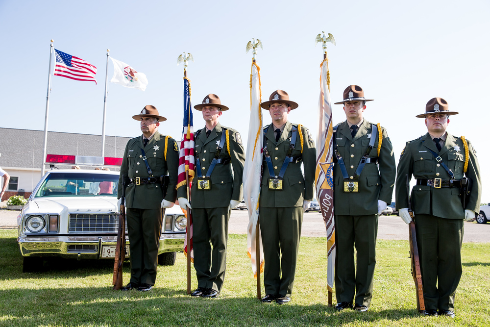 "Members of the Illinois State Police Honor Guard stand at attention prior to the Presentation of the Colors for a memorial ceremony for Trooper Bernard D. Skeeters, Friday, July 17, 2015, in Williamsville, Ill. The Stuttle Road overpass over Interstate 55 in Williamsville was renamed  the ""Trooper Bernard D. Skeeters Memorial Overpass"" to honor the trooper killed when his patrol car was struck from behind by a tractor trailer on I-55 in 1982. Justin L. Fowler/The State Journal-Register"